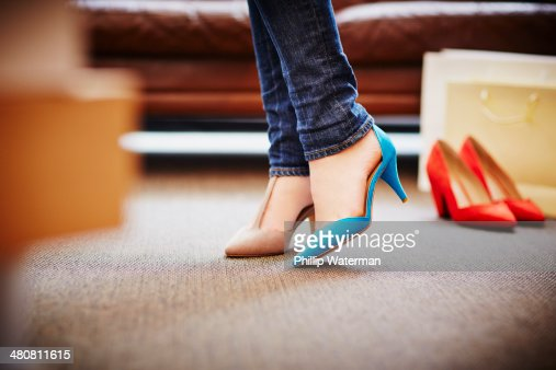 Woman trying on high heeled shoes