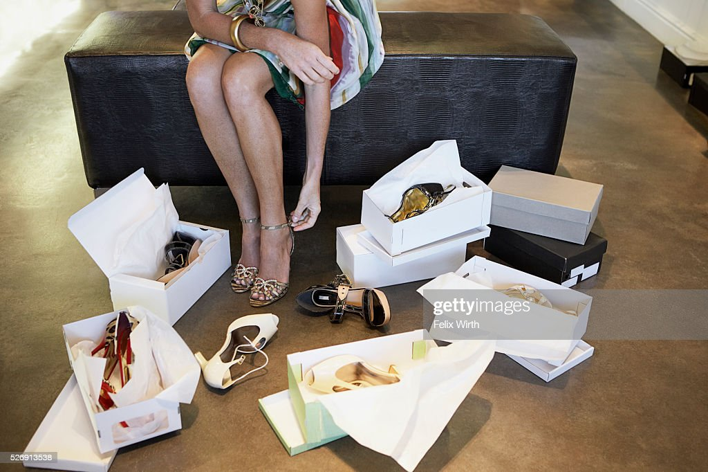 Woman trying on high heels : Stock Photo