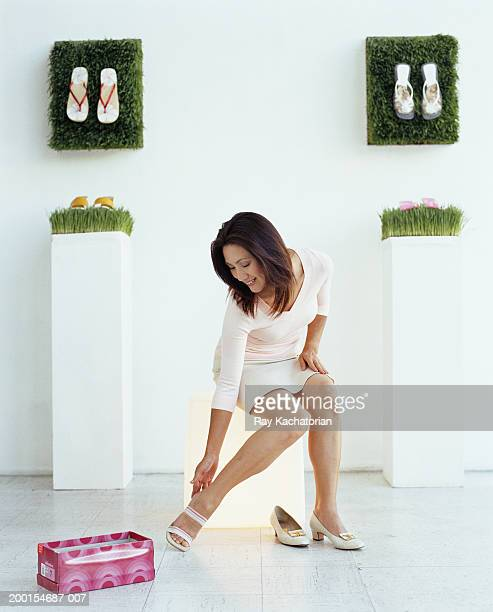 Woman trying on shoe in store