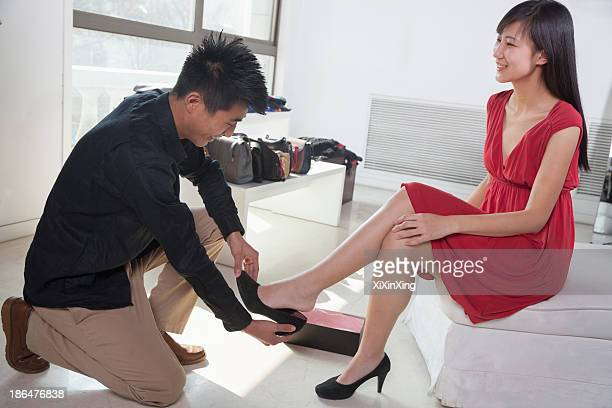 Woman trying on shoes at fashion store
