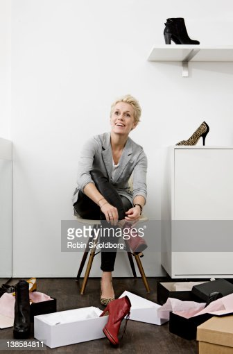 Woman trying shoes in shoe store
