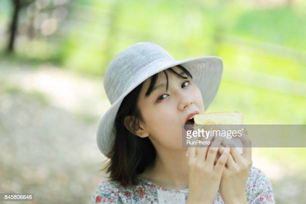 woman trying to eat bread
