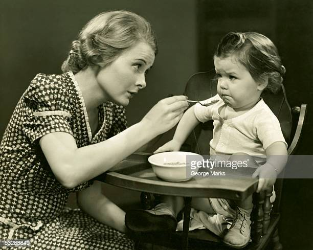 Woman trying to feed baby