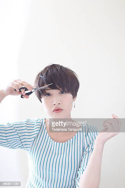 Woman trying to hair cut