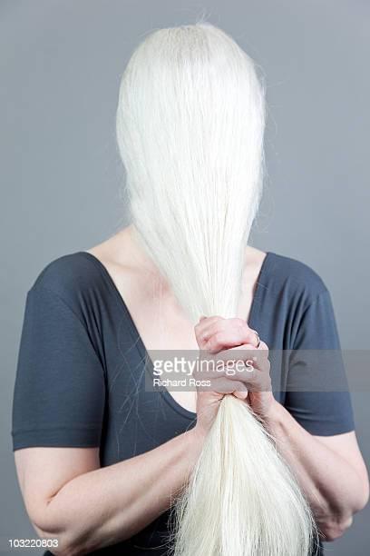 Woman Tugging at her Long White Hair