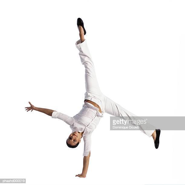 Woman turning cartwheel