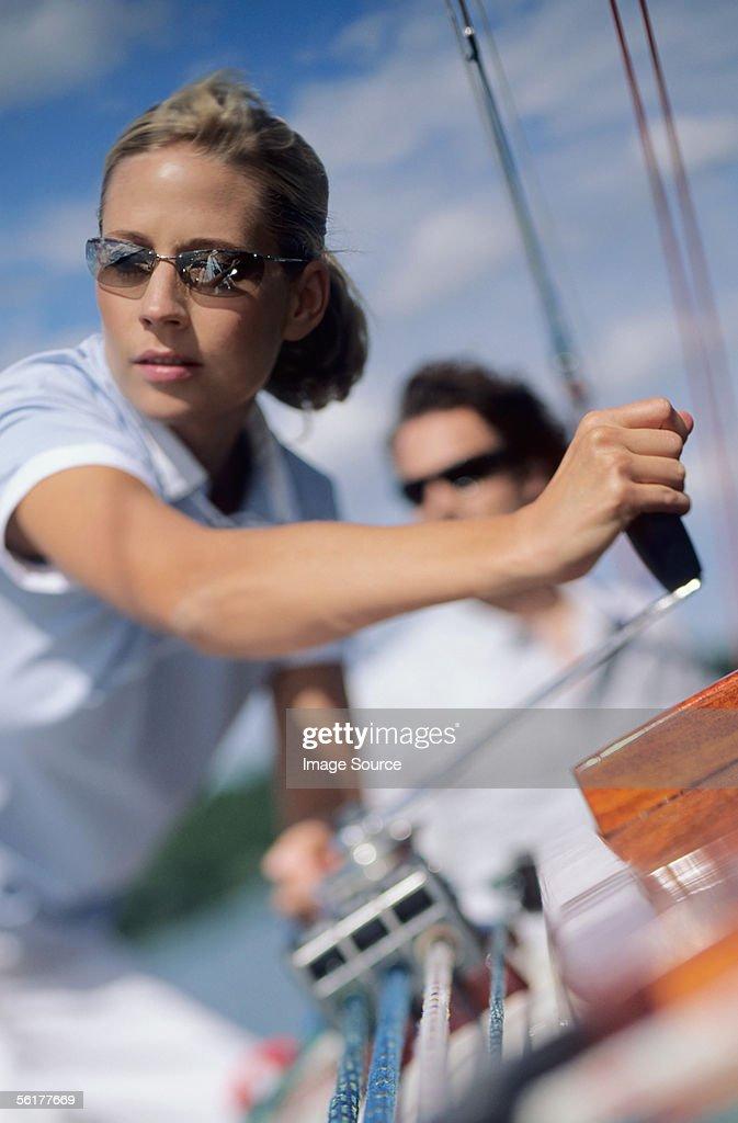 Woman turning crank handle : Stock Photo
