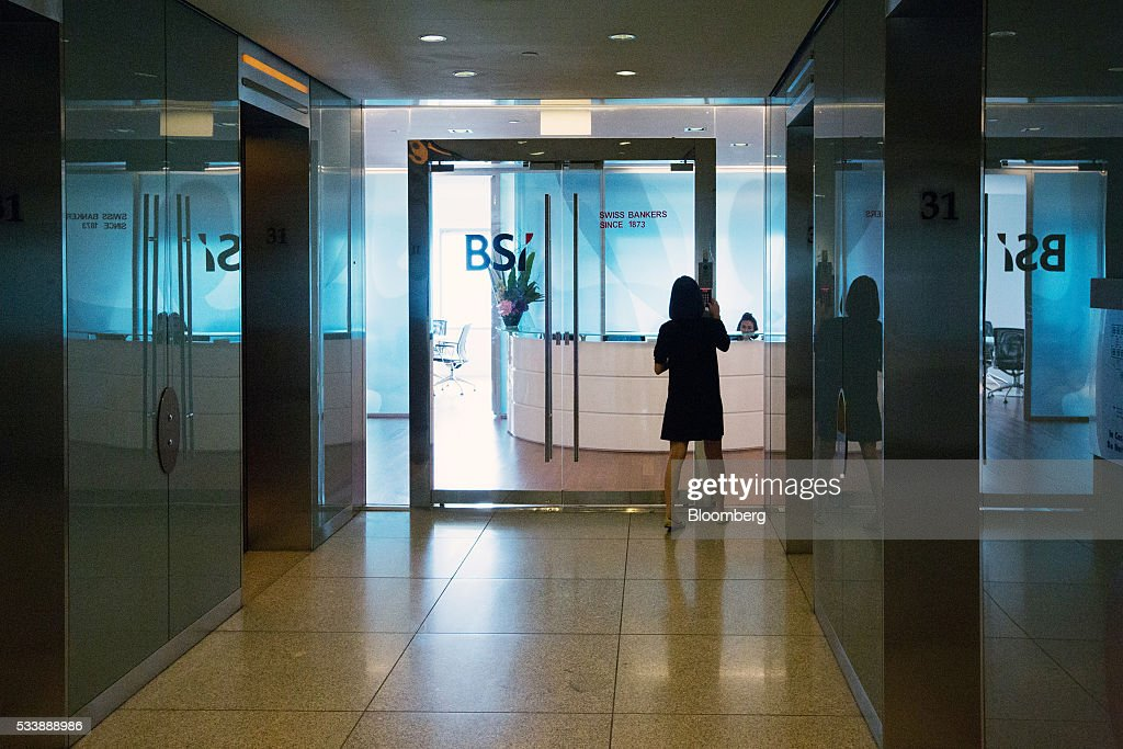 A woman types the entry code at the entrance to the BSI Bank Ltd. headquarters in Singapore, on Tuesday, May 24, 2016. Singapore ordered BSI's unit in the city-state to shut down as Swiss authorities began criminal proceedings against the bank, the biggest fallout suffered by a financial institution to date from global probes related to a troubled Malaysian state fund. Photographer: Nicky Loh/Bloomberg via Getty Images