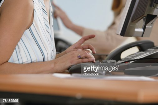 Woman typing in office : Stock Photo