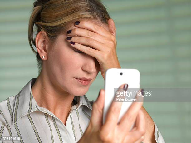Woman unable to look at smart phone
