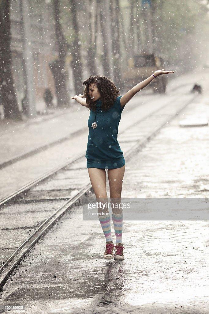 Woman under rain : Stock Photo