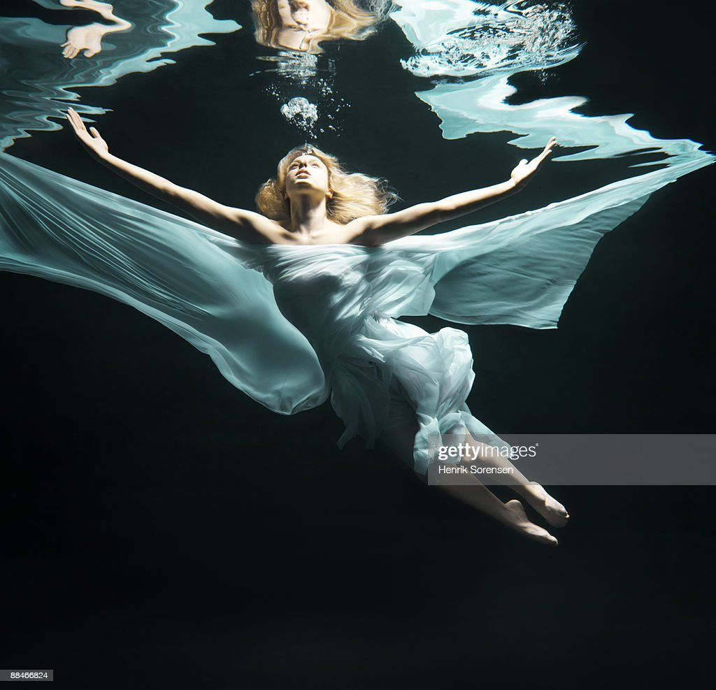 woman under water like an angel : Stock Photo
