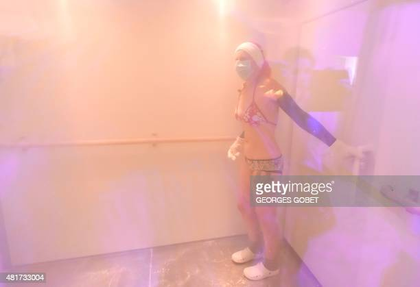 A woman undergoes a 'whole body cryotherapy' session at 110 degrees Celsius below zero at the 'Kemijoki' Cryotherapy Center in Rennes northwestern...