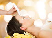 Close-up Of A Young Woman Undergoes Microdermabrasion Therapy On Forehead At Beauty Spa