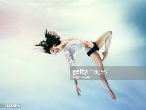 Woman underwater in zero gravity environment : Bildbanksbilder