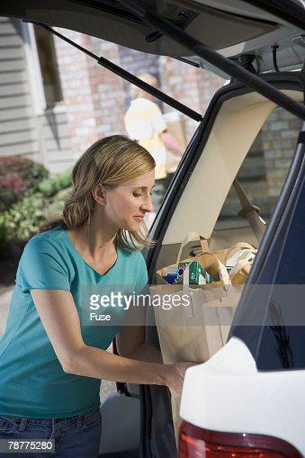 Woman Unloading Groceries