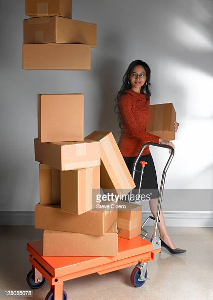 Woman unloading packages from cart