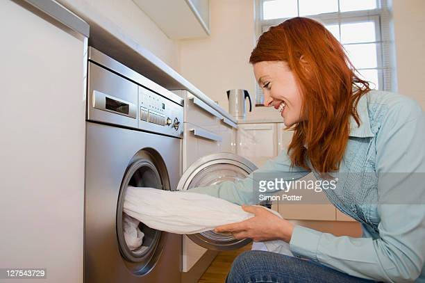 Woman unloading washing machine