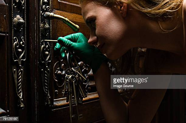 Woman unlocking an old door