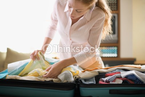 A girl unpacked from suitcase 5