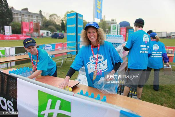 A woman unpacks bottled water on Blackheath before the start of the 2011 Virgin Money London Marathon on April 17 2011 in London England 36500...