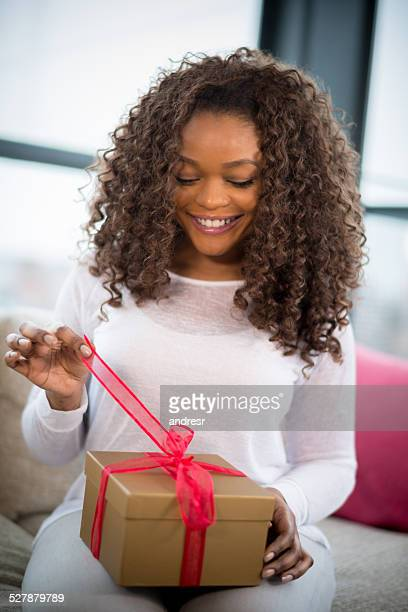 Woman unwrapping a gift