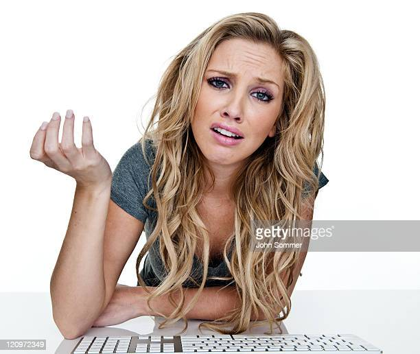 Woman upset with Computer keyboard