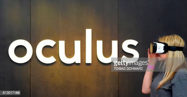 A woman use an 'Oculus VR' virtual reality device during a press preview of the 'Facebook Innovation Hub' in Berlin on February 24 2016 / AFP /...