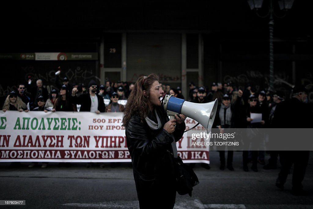 A woman uses a megaphone to shout slogans during a demonstration of the employees of the Greek Social Security Foundation (IKA) against austerity measures in front of the Labour Ministry in Athens on December 7, 2012. A Greek operation to buy back a chunk of the country's massive debt at reduced prices as a condition for further EU-IMF loans will conclude on December 7 as scheduled, a finance ministry source said.