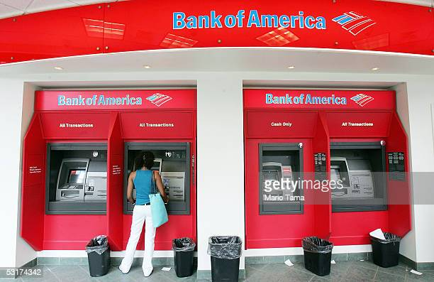A woman uses an ATM at A Bank of America branch June 30 2005 in New York City Bank of America Corp the second largest US bank agreed to buy MBNA Corp...