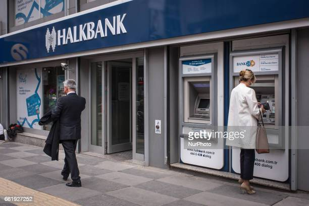 Woman uses an ATM to withdraw money at a branch office of Halkbank BranchTurkish staterun bank Halkbank had its deputy general manager Mehmet Hakan...