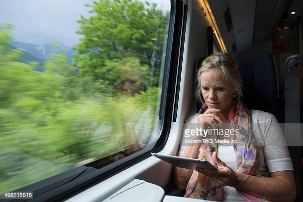 Woman uses digital tablet on board speeding train