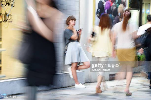 A woman uses her smartphone on July 16 2014 in Tokyo Japan Only 535% of Japanese owned smartphones in March according to a white paper released by...