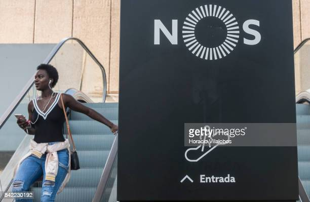 A woman uses the escalator at the headquarters of Portuguese 'NOS Comunicacoes' a GSM/UMTS/LTE mobile operator on August 30 2017 in Lisbon Portugal...