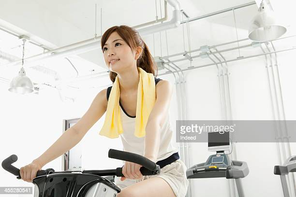 Woman uses the exercise bike