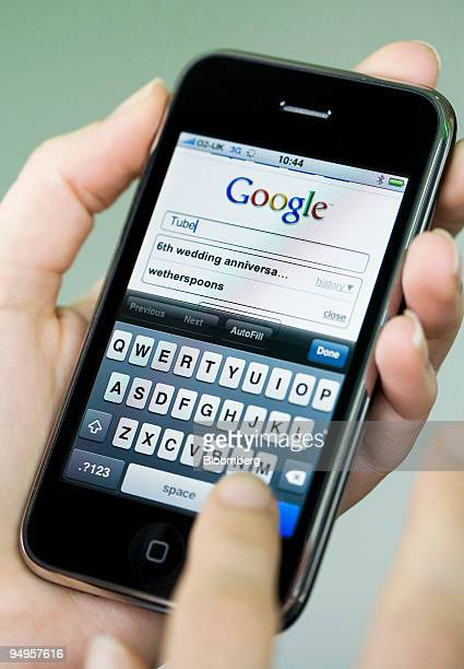 A woman uses the Google search engine on an Apple iphone in London UK on Tuesday Sept 15 2009 Apple Inc is the maker of the iPhone and the iPod media...