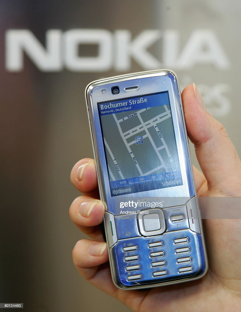 A woman uses the navigate tool on the Nokia N82 cell phone with an internal GPS receiver and Nokia map, at the CeBIT technology fair the first day the fair opened to the public March 4, 2008 in Hanover, Germany. CeBIT, the world's largest technology trade fair, will run from March 4-9.