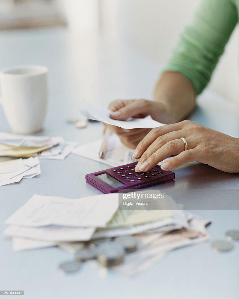 Woman Using a Calculator : Stock Photo