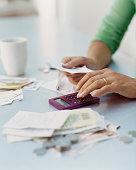 Woman Using a Calculator