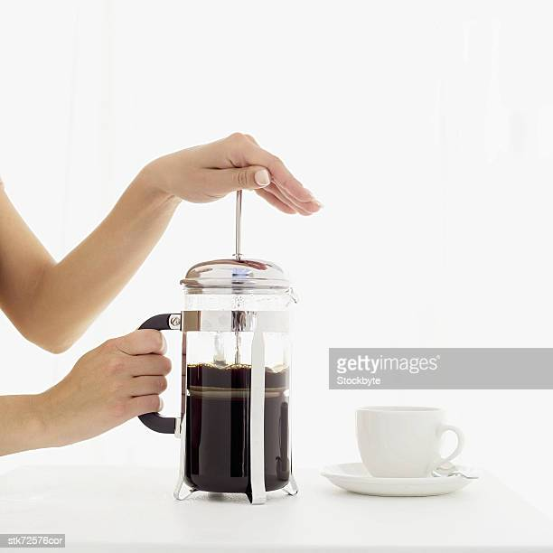 woman using a coffee plunger