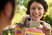 Woman using a digital camera outdoors