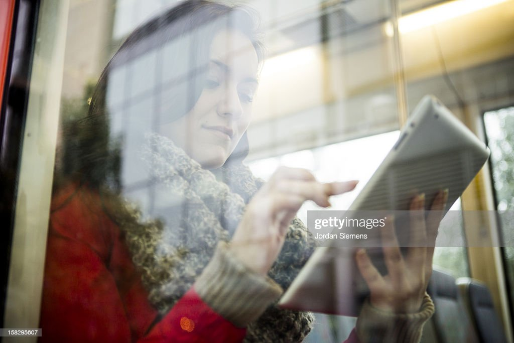 A woman using a digital tablet. : Stock Photo