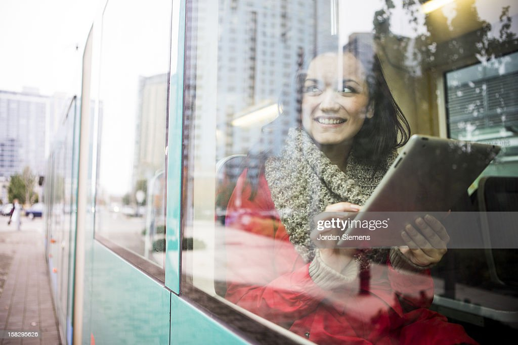 A woman using a digital tablet.
