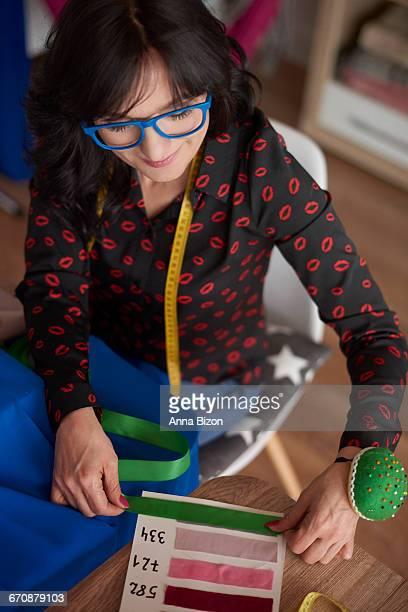 Woman using a fabric pattern board. Debica, Poland