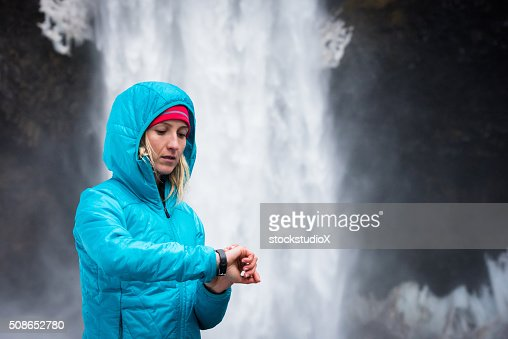 Woman using a fitness monitor : Stock Photo