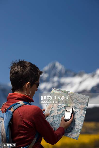 Woman using a GPS and Map