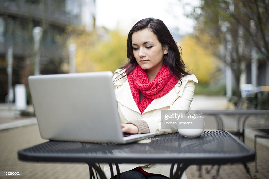 A woman using a laptop computer. : Stock Photo