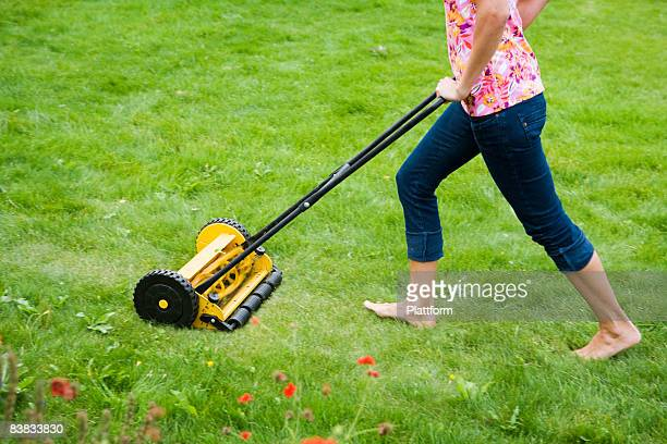 A woman using a lawn mower Sweden.