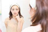 Woman using a mirror