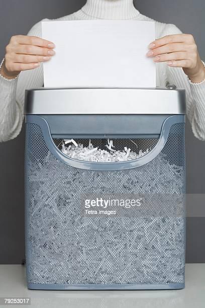 Woman using a paper shredder